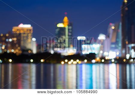 Abstract blurred bokeh lights of city downtown at night