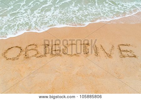 Objective Inscription Written On Sandy Beach With Wave Approaching