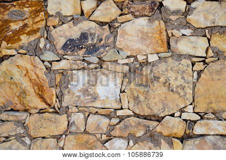 Yellow stone wall