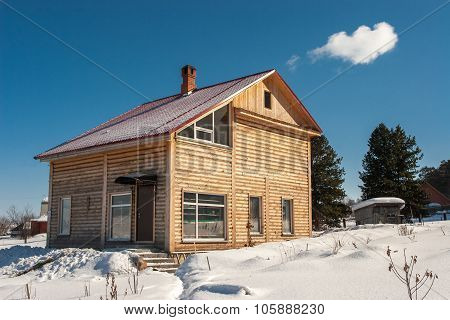 Log house in winter