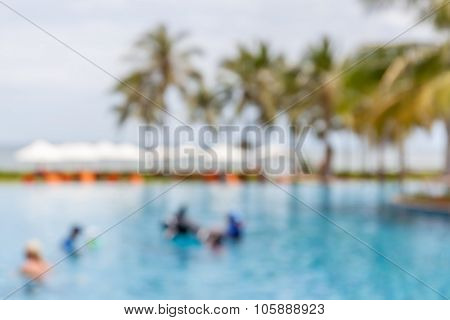 Blurred Photo Of People At Swimming Pool, Vacation Lifestyle Concept.