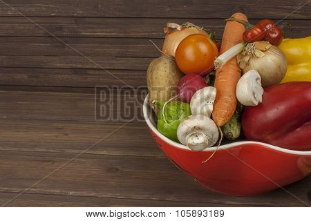 Vegetables in a red bowl on the table, instead of text.