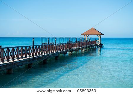 Long Wooden Jetty For Ships, Stretching Into The Sea