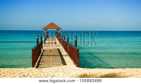 Wooden Berth For Ships Stretching Into The Sea