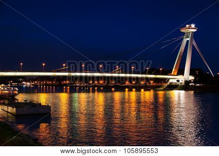 Night Illumination Of Danube River From Snp Bridge