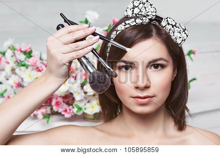 Beautiful young woman with tassels, skin care concept photo composition of brunette girl