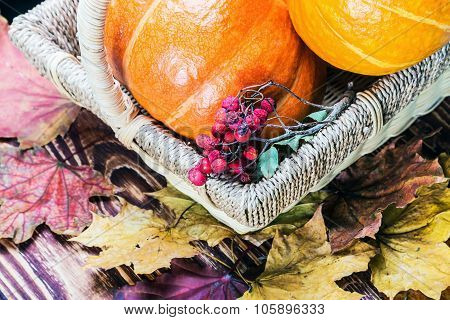 Pumpkins For Halloween In A Basket On A Wooden Table