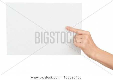 Girls hand with pointer finger holding blank card