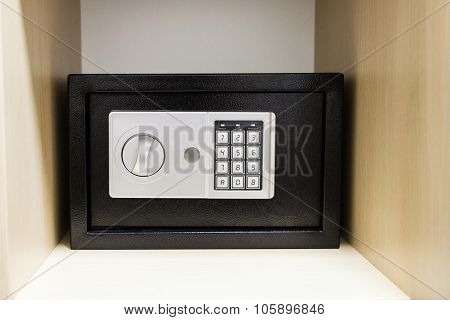 Compact Safe On Shelf Of Cabinet