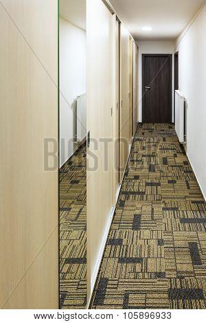 Narrow Corridor With Built-in Mirror Wardrobe