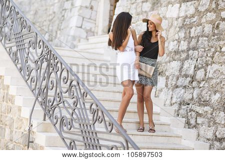 Young Women On The Stairs