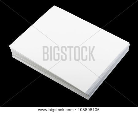 Blank sheet of paper on black, top view