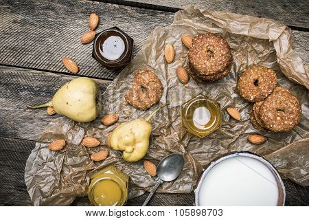 Tasty Pears Almonds Cookies And Cream On Rustic Wood