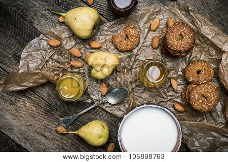 Almonds Pears Cookies And Joghrut On Wood Boards
