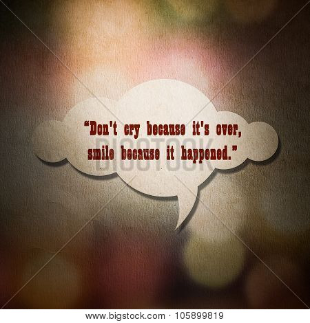 Meaningful Quote On Paper Cloud With Colorful Bokeh Background