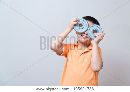 Asian Boy Joking Gesture Wearing Fake Glasses Made With Iron Dumbbell