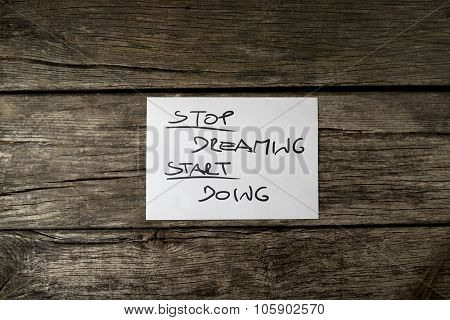 Top View Of A Stop Dreaming Start Doing Message