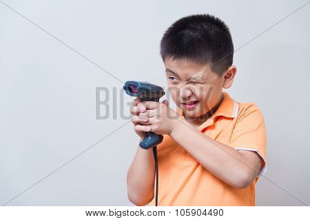 Asian Boy Aim A Fake Gun Made With Barcode Scanner