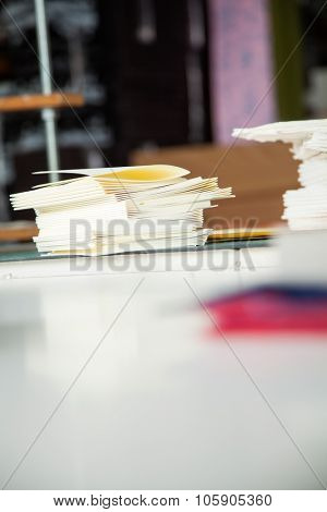 Closeup of notebook papers on table in factory