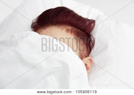 Red-haired Head In Bed Covered By Bedsheets