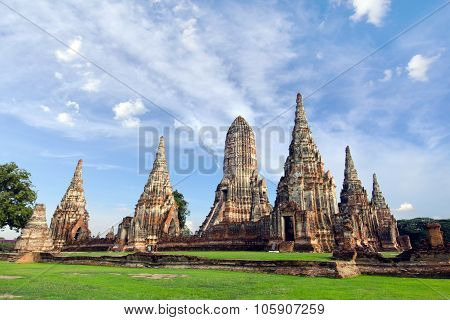 Old ruined buddha pagoda temple with cloudy white sky in Ayuthaya Thailand