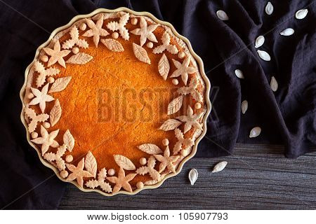 Delicious traditional thanksgiving pumpkin tart pie sweet organic dessert recipe with various decora