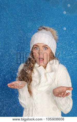 Surprised Woman In Winter Clothes With Snow