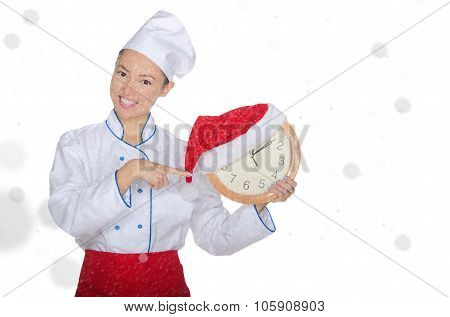 Asian Chef Points At Clock With Christmas Hat
