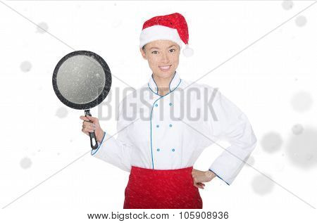 Smiling Asian Chef With Frying Pan And Christmas Hat