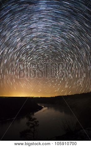 a beautiful night sky Milky Way star trails and the trees