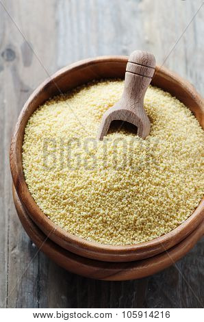 Uncooked Couscous On The Wooden Table