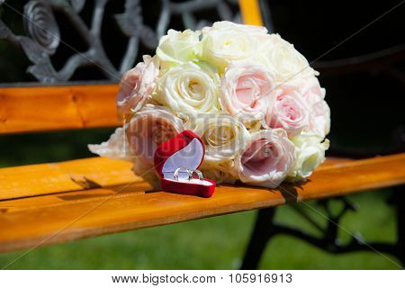 Betrothal Detail Of The Rings And Bouquet