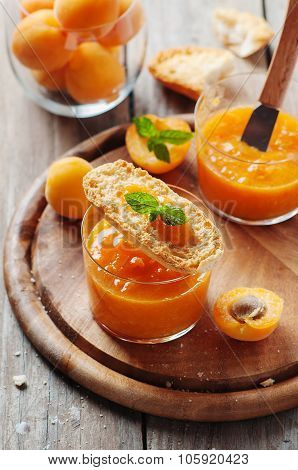 Apricot Jam With Bread on the wooden table
