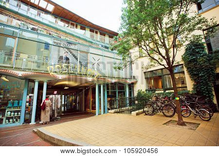 Old Luxury Shopping Mall With Bicycle Parking And Trees