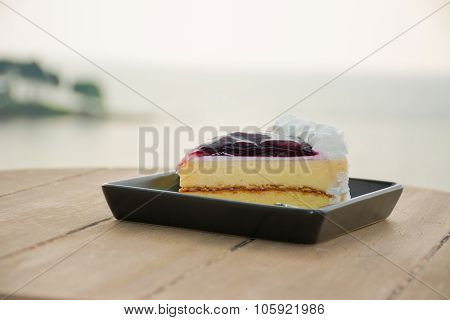 Blueberry Cheesecake In Evening With Beautiful Sea In Background