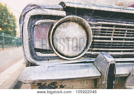 Detail Of The Front Headlight Of An Old Car