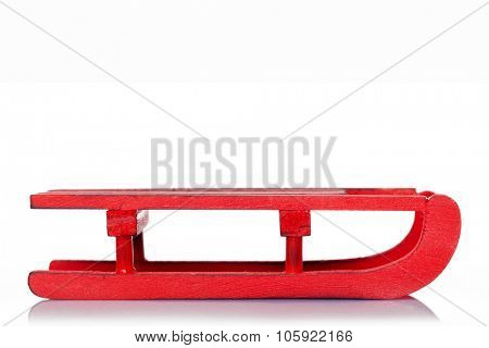 Red sled isolated over white background