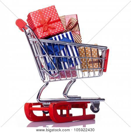 Red sled and shopping cart with gift boxes, isolated on white background