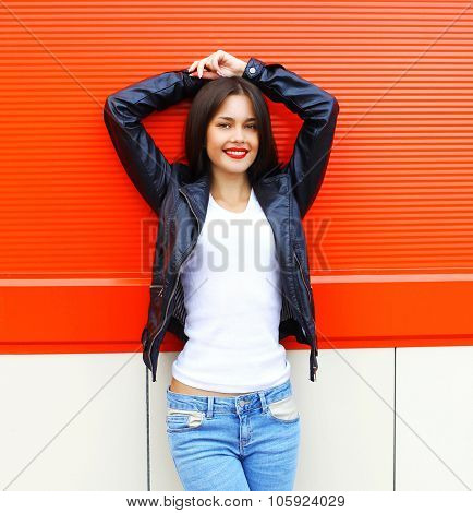 Portrait Beautiful Smiling Young Brunette Woman Wearing A Rock Black Leather Jacket And Jeans Posing