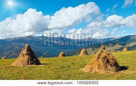 Haystacks On Mountain Plateau