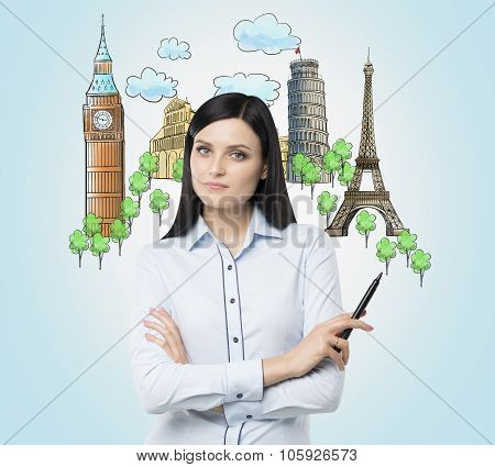A Brunette Woman Offers The Visiting Of The Most Famous Cities In Europe. The Concept Of Tourism And