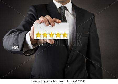 Businessman showing five star on business card