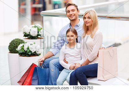 Friendly family sitting on the bench