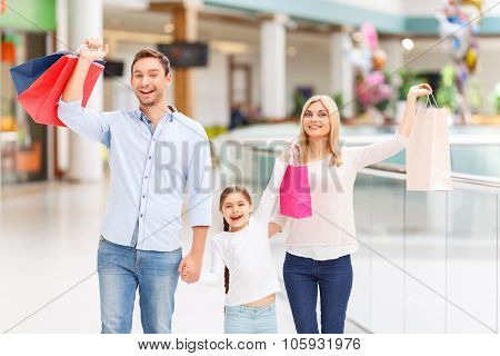 Friendly family walking around shopping mall