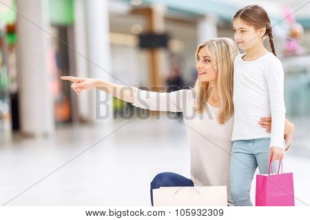 Mother and daughter having shopping