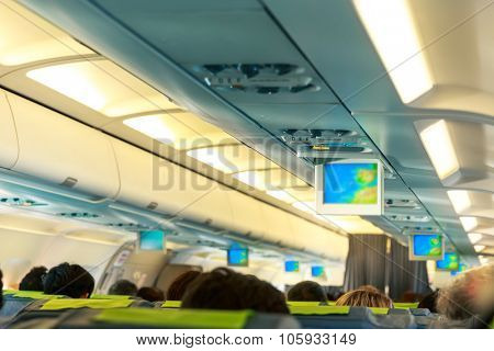 People sitting on the seats in the plane salon