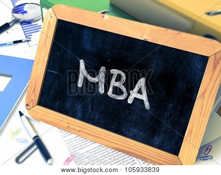 MBA Concept Hand Drawn on Chalkboard.