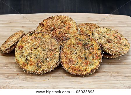 Fried Eggplant Slices On A Cutting Board.