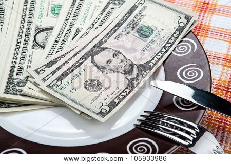 Dollar Bills On A Plate