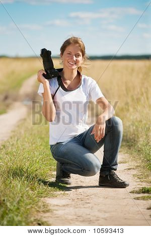 Girl With Photocamera  At Field